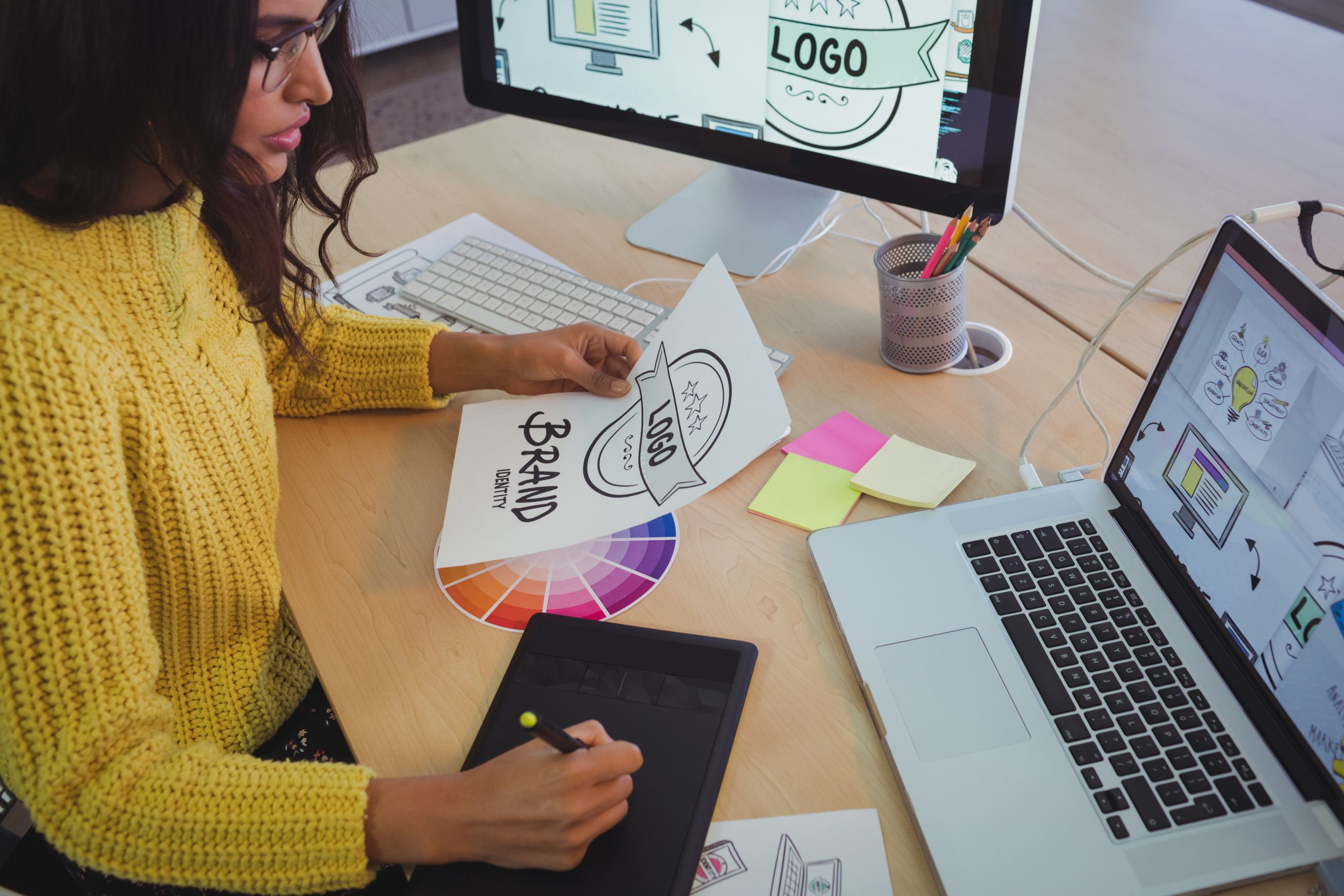 Young graphic designer working at office desk